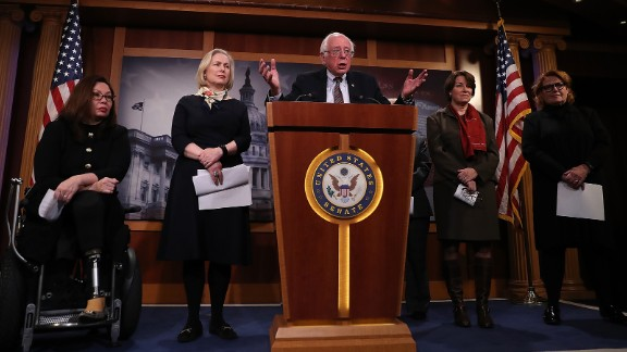 WASHINGTON, DC - MARCH 14:  (L-R) U.S. Sen. Tammy Duckworth (D-MN), Sen. Kirsten Gillibrand (D-NY), Sen. Bernie Sanders (I-VT), Sen. Amy Globuchar (D-MN) and Sen. Heidi Heitkamp (D-ND) attend a news conference at the U.S. Capitol on March 14, 2017 in Washington, DC. Senate Democrats annouced legislation to ensure American workers receive paid medical and family leave.  (Photo by Justin Sullivan/Getty Images)