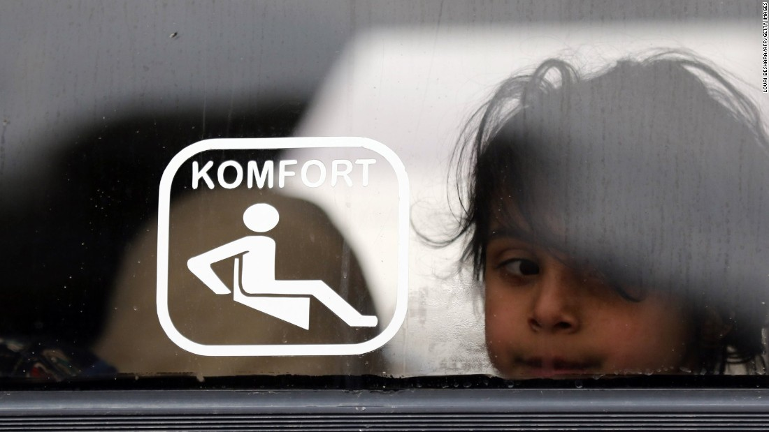 A Syrian girl looks on as she sits on a bus waiting to leave Homs.