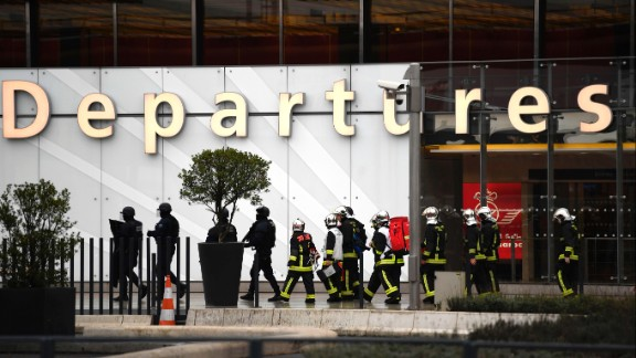 French firefighters and RAID police unit officers secure Paris