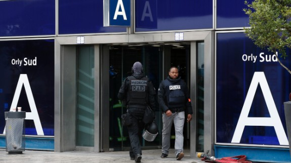 French elite police forces patrol the airport departure area.