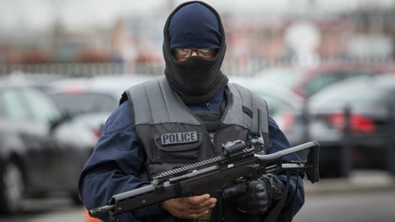 An elite police officer stands guard at Orly airport.