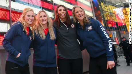 NEW YORK, NY - FEBRUARY 08:  (L-R)  Olympic hopefulls Jocelyne Lamourex, Monique Lamoureux, Hilary Knight and Meghan Duggan pose for a photo outside the NASDAQ Stock Market on Febuary 8, 2017 in New York City. Team USA celebrates the one-year countdown to the Olympic Winter Games PyeongChang 2018.  (Photo by Mike Stobe/Getty Images for the USOC)