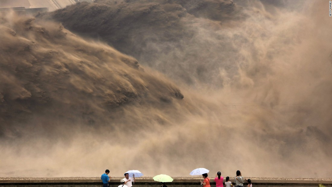 Elsewhere in China, visitors gather to watch giant gushes of water being released from the Xiaolangdi dam to clear up the sediment-laden Yellow river and to prevent localized flooding, in Jiyuan, central China's Henan province.