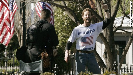 Brian Lee Patterson, right, shouts as he is approached by a member of the Secret Service Emergency Response Team on the North Lawn of the White House,  April 9, 2006 in Washington.