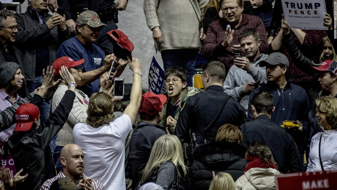 "A protester yells at Trump supporters at a rally held by the President in Nashville, Tennessee, on Wednesday, March 15. During his speech, Trump <a href=""http://www.cnn.com/2017/03/15/politics/donald-trump-travel-ban-judge-ruling/"" target=""_blank"">decried a federal judge's decision</a> to block his latest travel ban, saying it endangers national security and makes the United States look weak."