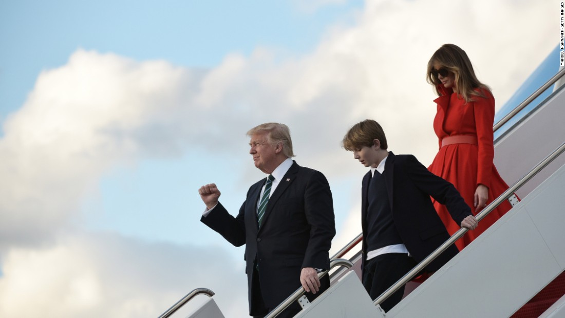President Donald Trump, first lady Melania Trump and their son Barron leave Air Force One after arriving in West Palm Beach, Florida, on Friday, March 17.