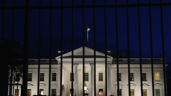 A tall security fence stands in front of the White House in this November 4, 2014, file photo.