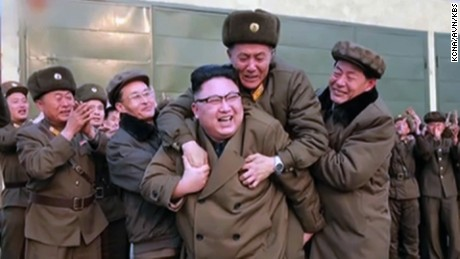 Leader Kim Jong Un is congratulated after the rocket engine test.