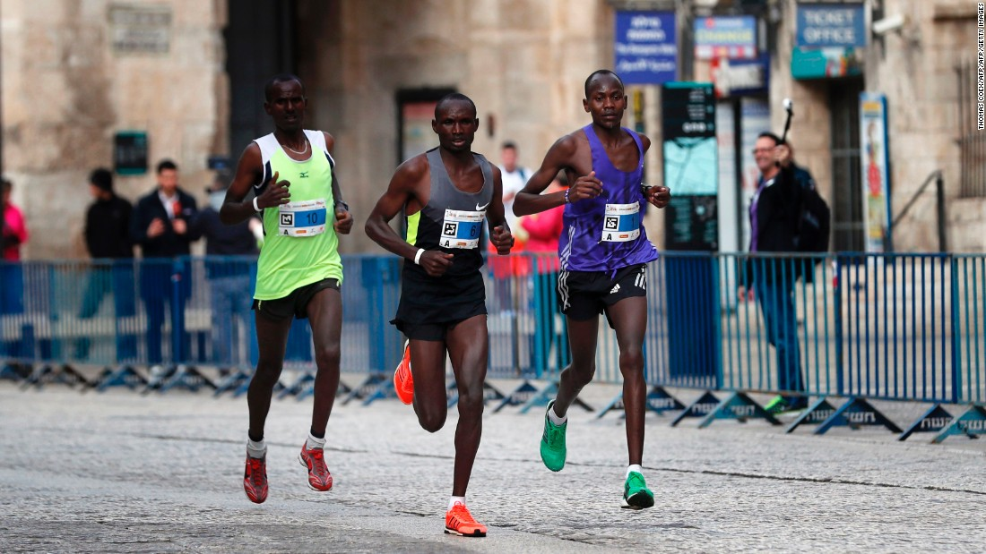 Kenya's Shadrack Kipkosgei (right) won the marathon for the second year in a row, in a time of 2:17:36, picking up the $3,750 prize. Ethiopia's Wendwesen Tilahun Damte (left) was second and Kenya's Matthew Kibiwott Sang (center) was third.