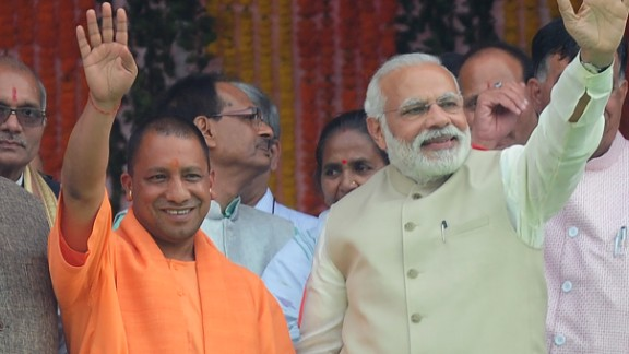 Chief Minister of Uttar Pradesh state Yogi Adityanath (C), Indian Prime Minister Narendra Modi (R) and Bharatiya Janata Party (BJP) president Amit Shah attend Adityanath