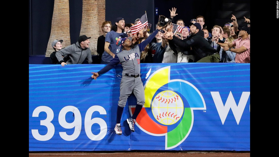 "US outfielder Adam Jones steals a home run during a second-round game at the World Baseball Classic on Saturday, March 18. Manny Machado, the Dominican player who hit the ball, <a href=""http://bleacherreport.com/articles/2698807-adam-jones-robs-manny-machado-of-home-run-at-world-baseball-classic"" target=""_blank"">tipped his cap to Jones,</a> his teammate with the Baltimore Orioles. The Americans advanced to the semifinals with a 6-3 victory."