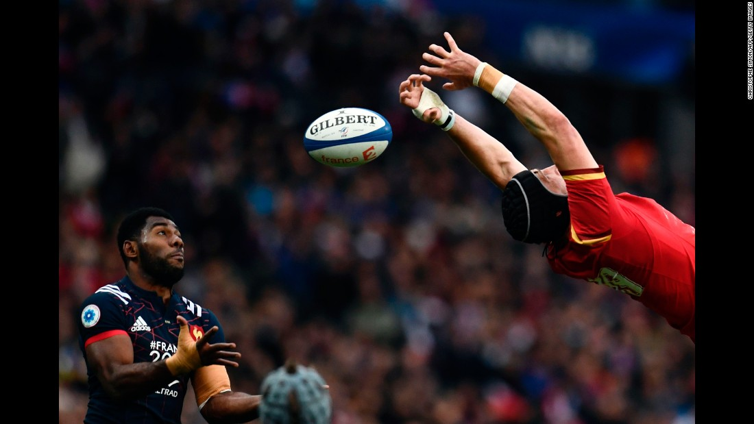 French rugby player Noa Nakaitaci, left, tries to catch the ball as it slips past Wales' Samson Lee during a Six Nations match on Saturday, March 18.