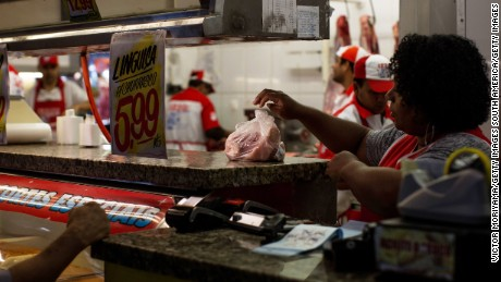 SAO PAULO, BRAZIL - MARCH 20:  A worker packages meat for sale to a customer at a public market March 20, 2017 in Sao Paulo, Brazil. Brazilian Federal Police launched a major operation in several Brazilian states with search and arrest warrants for directors of the country's main meat-producing companies, such as JBS and BRF.  Thirty-three employees of the Ministry of Agriculture were removed from office for alleged involvement in a corruption scheme and receiving a bribe for allowing spoiled meat to circulate in Brazilian supermarkets.  (Photo by Victor Moriyama/Getty Images)