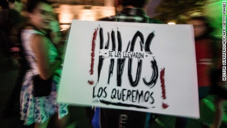 Parents, other relatives and people in general take part in a protest in Guadalajara, on September 26, 2016, to commemorate the second anniversary of the Ayotzinapa teachers school's students disappearance.  The students, from a rural teachers college in the southern state of Guerrero, disappeared after they were attacked by local police in the city of Iguala on September 26, 2014. / AFP / HECTOR GUERRERO        (Photo credit should read HECTOR GUERRERO/AFP/Getty Images)