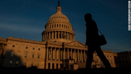 WASHINGTON, D.C. - MARCH 20:  A person walks by as the sun rises near The United States Capitol Building on March 20, 2017 in Washington, D.C. The Senate will hold a confirmation hearing for Supreme Court Nominee Neil Gorsuch and FBI Director James Comey will testify before the House Permanent Select Committee on Intelligence on alleged Russian interference in the 2016 election. (Photo by Zach Gibson/Getty Images)