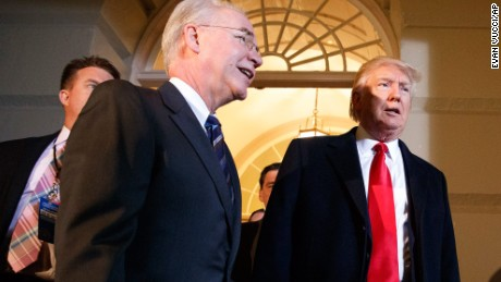 President Donald Trump and Heath and Human Services Secretary Tom Price arrive on Capitol Hill in Washington, Tuesday, March 21, 2017, for a meeting on healthcare with Republicans. (AP Photo/Evan Vucci)