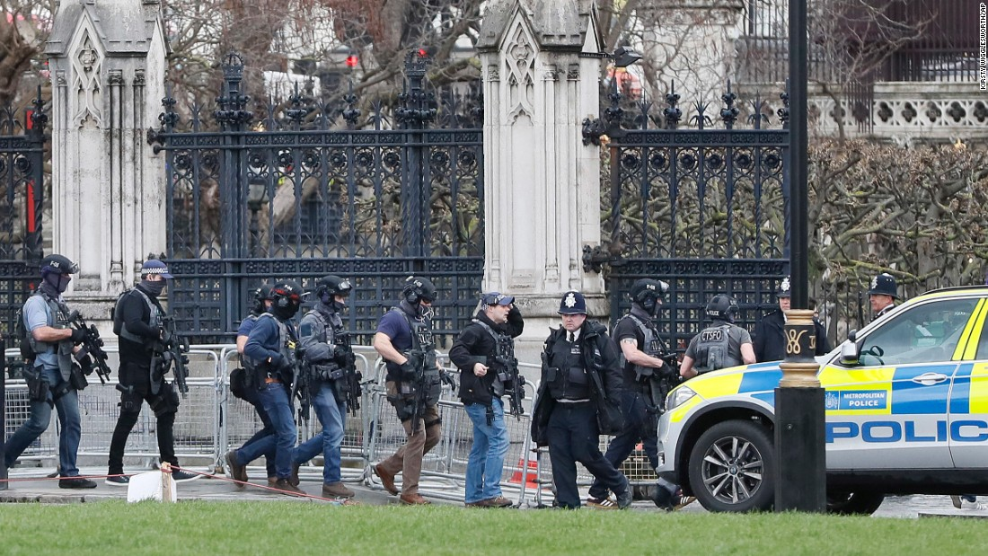 Armed police enter the Houses of Parliament.