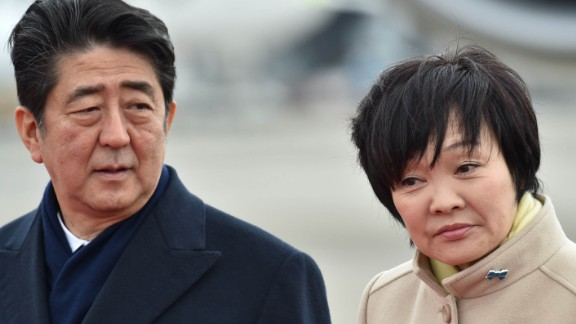 Japan's Prime Minister Shinzo Abe and his wife Akie see off Emperor Akihito and Empress Michiko as they leave for Vietnam from Tokyo's Haneda Airport on February 28.