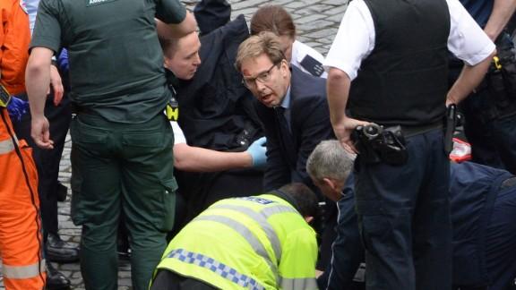 Member of Parliament Tobias Ellwood, in the glasses, tends to one of the injured people amid the chaos. The man the politician was trying to save was a police officer who died, a witness on the scene told CNN. Authorities identified the deceased officer as Keith Palmer, 48.