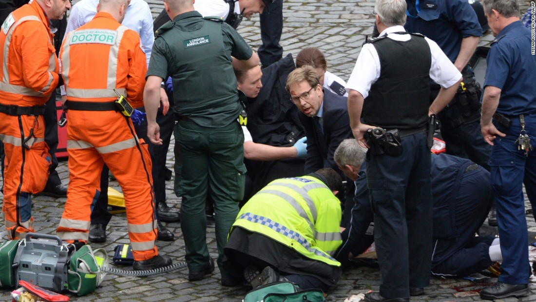 "Member of Parliament Tobias Ellwood, in the glasses, <a href=""http://edition.cnn.com/2017/03/22/world/tobias-ellwood-london-rescue/index.html"" target=""_blank"">tends to one of the injured people</a> amid the chaos. The man the politician was trying to save was a police officer who died, a witness on the scene told CNN. Authorities identified the deceased officer as Keith Palmer, 48."