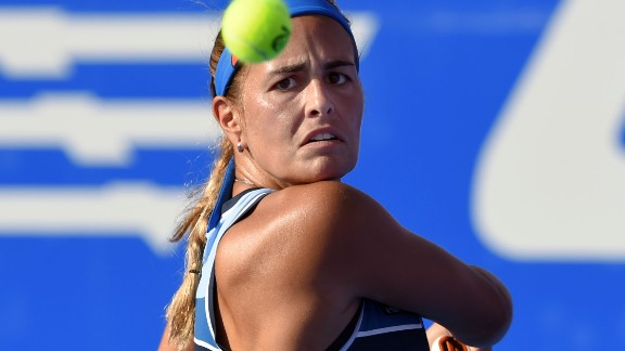 Puerto Rican tennis player Monica Puig returns the ball to Czechoslovakian player Daniela Hantuchova during their Mexican Tennis Open match, in Acapulco, Guerrero State, Mexico on March 1, 2017. / AFP PHOTO / ALFREDO ESTRELLA        (Photo credit should read ALFREDO ESTRELLA/AFP/Getty Images)