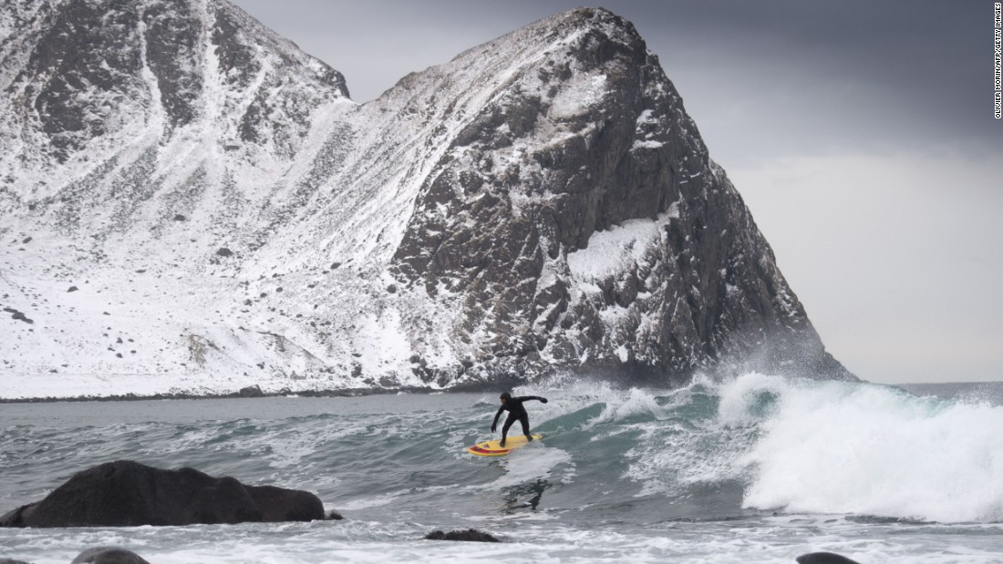 "<strong>Unstad, Norway:</strong> <a href=""/2013/11/20/travel/best-northern-lights/index.html"" target=""_blank"">Unstad</a> -- north of the Arctic Circle --  is home to the world's most northerly surf school, Unstad Arctic Surf. Tom Carroll, an Australian former world champion surfer, rides a wave."