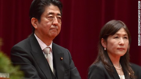 Japanese Prime Minister Shinzo Abe (left) and Defense Minister Tomomi Inada (right) attend the graduation ceremony of the National Defense Academy on March 19.