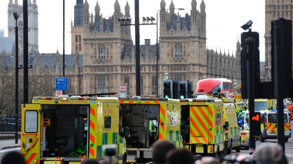 "Ambulances wait as members of the emergency services work on Westminster Bridge, alongside the Houses of Parliament in central London on March 22, 2017, during an emergency incident. British police shot a suspected attacker outside the Houses of Parliament in London on Wednesday after an officer was stabbed in what police said was a ""terrorist"" incident. One woman has died and others have ""catastrophic"" injuries following a suspected terror attack outside the British parliament, local media reported on Wednesday citing a junior doctor. / AFP PHOTO / NIKLAS HALLE'N        (Photo credit should read NIKLAS HALLE'N/AFP/Getty Images)"