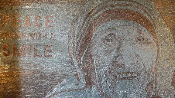 Artist Saimir Strati was inspired by the refugee crisis to create Mother Teresa's smiling portrait.