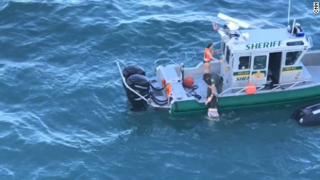 Deputy performs dramatic rescue of jet skiers in path of cruise ship