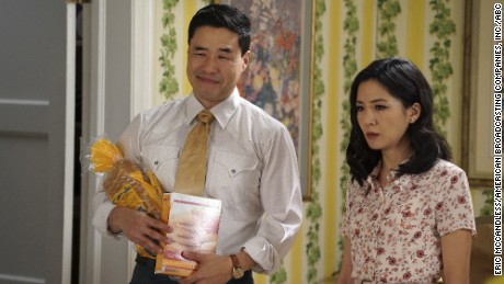 "Randall Park and Constance Wu star as Loius and Jessica Huang on ""Fresh Off the Boat."""