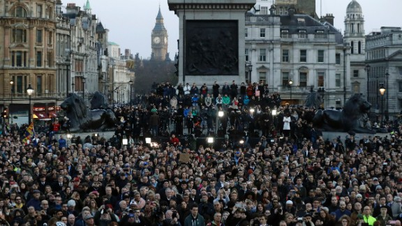 A somber crowd gathers in London