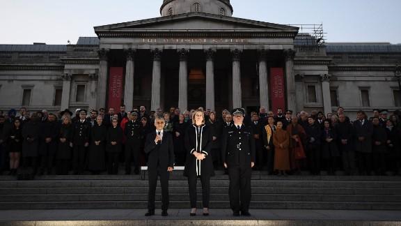 London Mayor Sadiq Khan speaks as UK Home Secretary Amber Rudd and Metropolitan Police Acting Commissioner Craig Mackey look on.