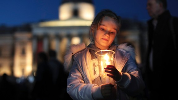A young girl holds a candle during the vigil.