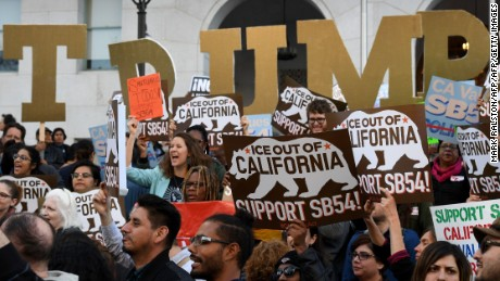 Migrant rights protesters demonstrate outside the Hall of Justice against the use of state police resources for federal immigration enforcement and deportation in Los Angeles, California, on March 22, 2017. / AFP PHOTO / Mark RALSTON        (Photo credit should read MARK RALSTON/AFP/Getty Images)