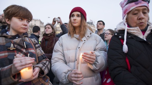 """A crowd gathers in Trafalgar Square on Thursday, March 23, for a candlelit vigil to honor the victims of Wednesday's attack near Parliament in London. Emily Nye, a 21-year-old student at Goldsmiths, University of London, (center) says she was """"devastated, but not surprised"""" to hear of the rampage."""