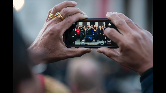 A person in the crowd captures a moment from the memorial ceremony on the steps of Trafalgar Square.