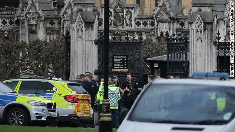 Armed police officers stand guard, as ambulance paramedics arrive at the Carriage Gates entrance of the Houses of Parliament in central London on March 22, 2017, during an emergency incident.
