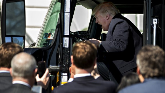 President Trump pretends to drive a truck during an event with truckers and truck industry executives on the South Lawn of the White House on Thursday, March 23.