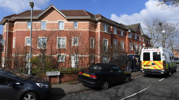 A police van is outside a residential building Thursday in Birmingham.