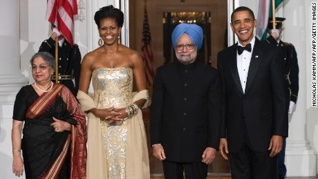Michelle Obama wears a gown by Indian fashion designer Naeem Khan during a visit by Indian Prime Minister Manmohan Singh in 2009.