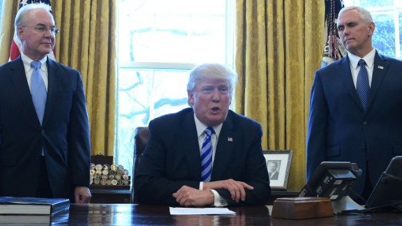 US President Donald Trump, with Vice President Mike Pence (R) and Health and Human Services Secretary Tom Price (L), speaks from the Oval Office of the White House in Washington, DC, on March 24, 2017. Trump on Friday asked US Speaker of the House Paul Ryan to withdraw the embattled Republican health care bill, moments before a vote, signaling a major political defeat for the US president. / AFP PHOTO / MANDEL NGAN        (Photo credit should read MANDEL NGAN/AFP/Getty Images)