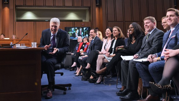 Neil Gorsuch, Supreme Court nominee, laughs at a senator