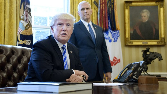 "President Donald Trump speaks to members of the media as Vice President Mike Pence looks on in the Oval Office on Friday, March 27, after Republicans were forced to pull a health care bill that aimed to repeal and replace Obamacare. ""We had no votes from the Democrats. They weren"