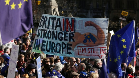 Demonstrators hold a placard during an anti Brexit, pro-European Union (EU) march in London on March 25, 2017, ahead of the British government's planned triggering of Article 50 next week. Britain will launch the process of leaving the European Union on March 29, setting a historic and uncharted course to become the first country to withdraw from the bloc by March 2019. / AFP PHOTO / DANIEL LEAL-OLIVAS        (Photo credit should read DANIEL LEAL-OLIVAS/AFP/Getty Images)