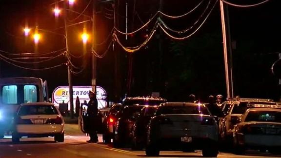 Police offficers investigate the crime scene at a Cincinnati nightclub.
