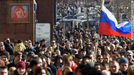 Protesters walk along Moscow's Tverskaya street during an unauthorised anti-corruption rally on March 26, 2017. Thousands of Russians are protesting across the country in rallies called by opposition leader Alexei Navalny. Navalny called for the demonstrations after publishing a detailed report this month accusing Prime Minister Dmitry Medvedev of controlling a property empire through a shadowy network of non-profit organizations.