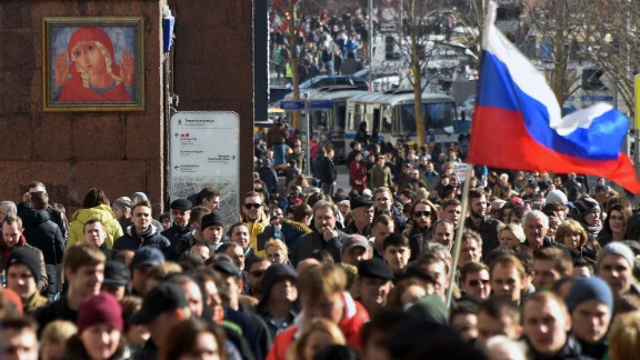Protesters walk along Moscow