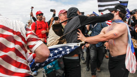 A scuffle breaks out between Pro-Trump and Anti-Trump protestors during Make America Great Again March on March 25, 2017 in Huntington Beach. According to reports, an anti-Trump protester doused an event organizer with pepper spray prompting Trump supporters to retaliate.