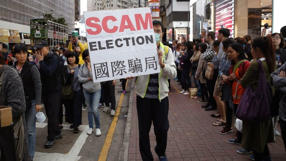 Protesters gathered outside the Hong Kong Convention and Exhibition Center, where votes were being counted.